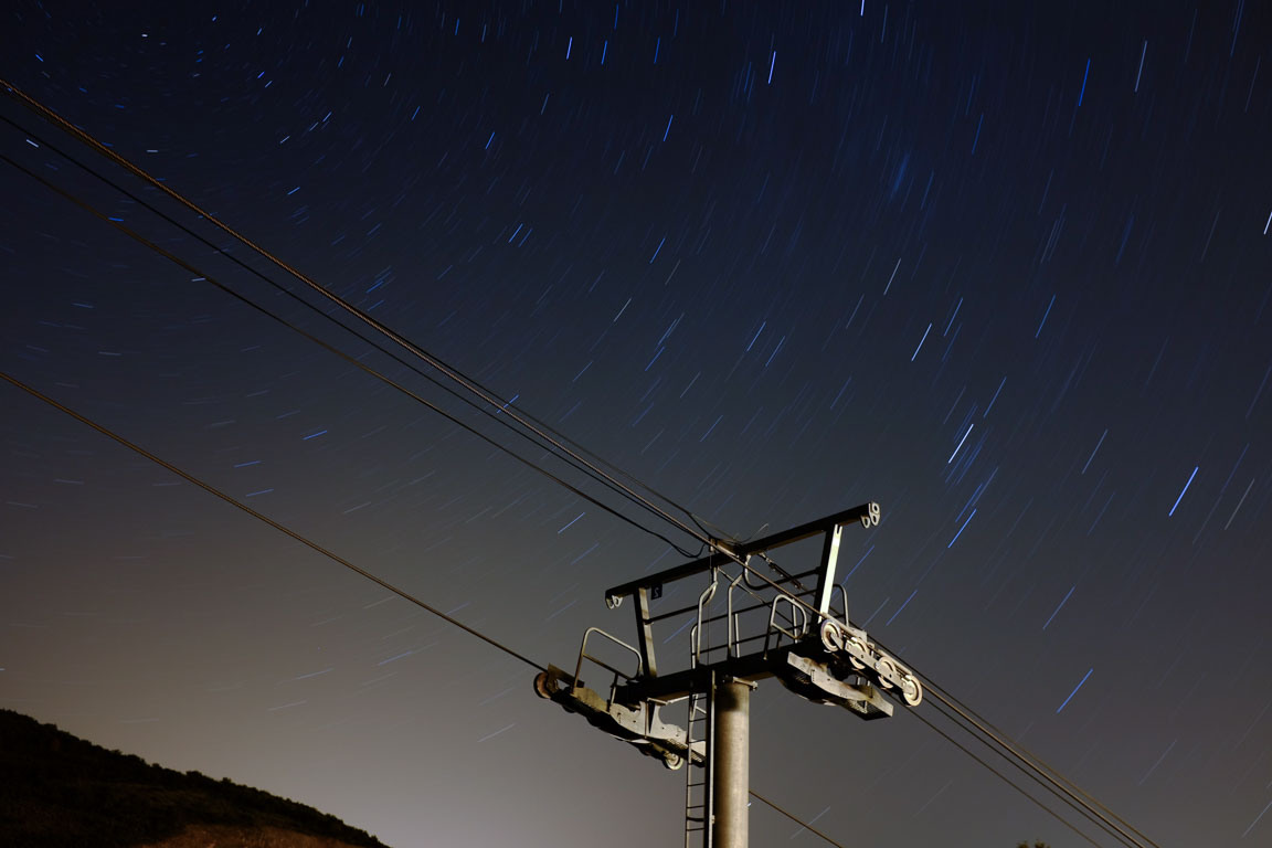 Fuji X100S at f/5.6 for 11min 20sec (ISO 200). It probably should've been at least an extra stop and twice as long to get better defined star trails